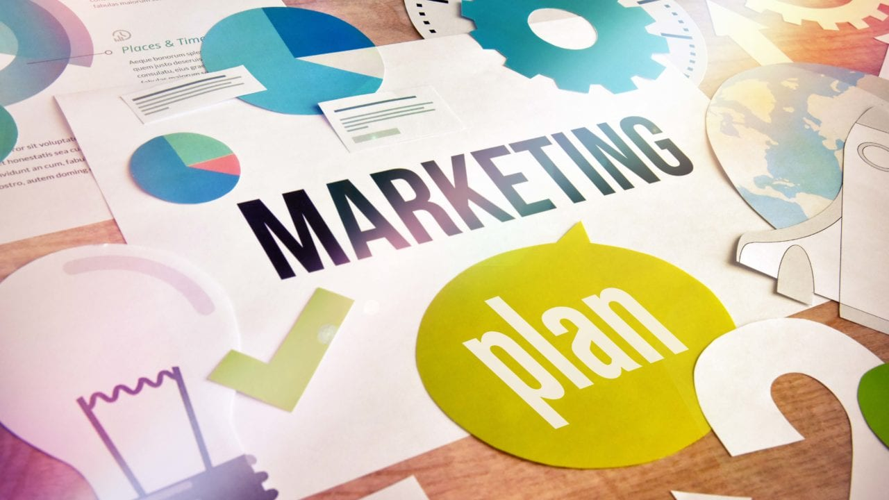 overhead view of graphs, graphics and words marketing plan